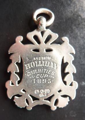 Ch_11_Pic_2_Holliday_Cup_Medal_back.jpeg.jpg